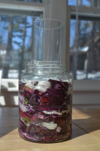 Sauerkraut jar with glass in it for weight
